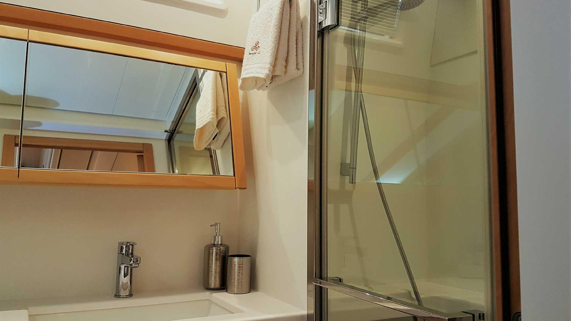 Master Bedroom Shower on Crewed Charter Catamaran