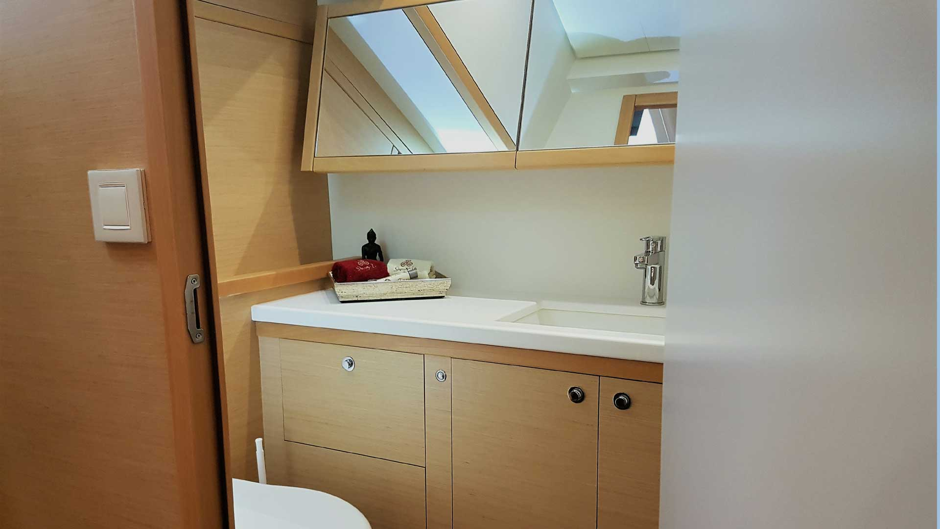 Master Bedroom Bathroom and Shower on Crewed Charter Catamaran